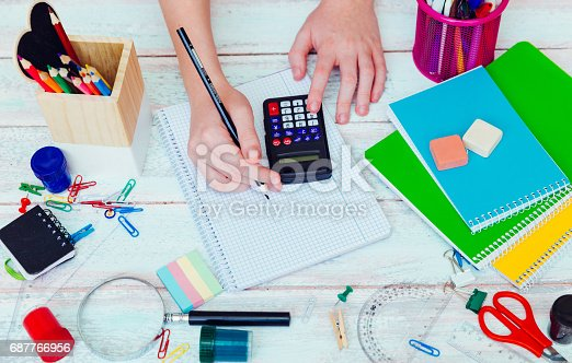 818533812 istock photo schoolgirl on math lesson checking the result on calculator 687766956