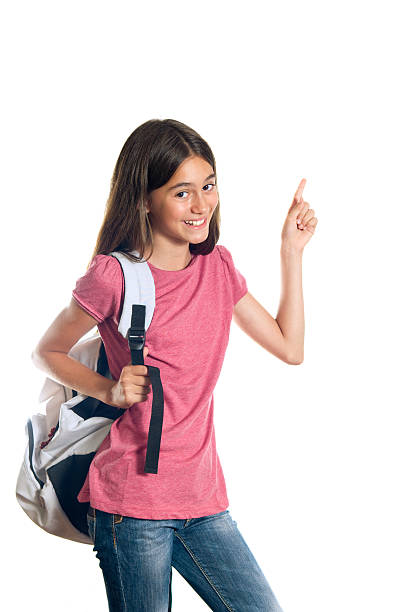 Schoolgirl pointing up stock photo