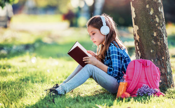 Schoolgirl reading a book. Education, lifestyle concept stock photo