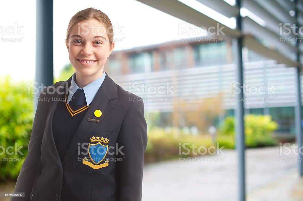 schoolgirl stood outside her school stock photo