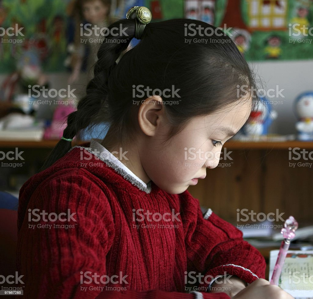 schoolgirl studying at home royalty-free stock photo