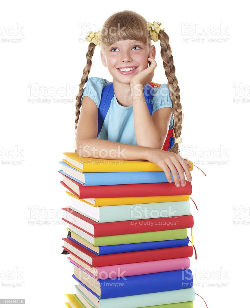 Schoolgirl with backpack holding pile of books. royalty-free stock photo