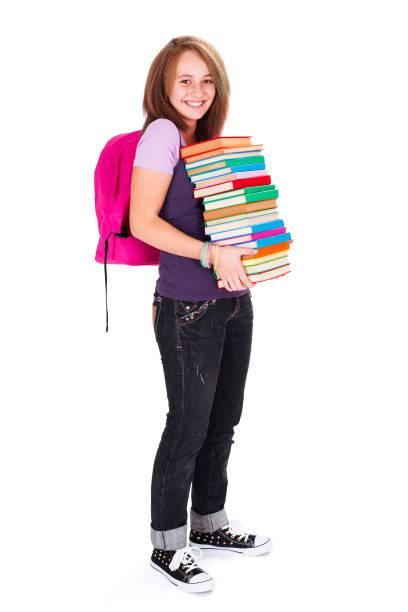Schoolgirl with books stock photo