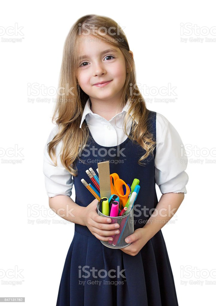 Schoolgirl with school supplies isolated. stock photo