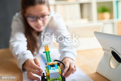 865870702 istock photo Schoolgirl with self-made robot 629727010