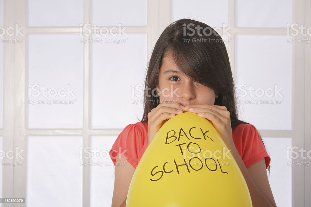 Schoolgirl With Yellow Back To School Balloon stock photo