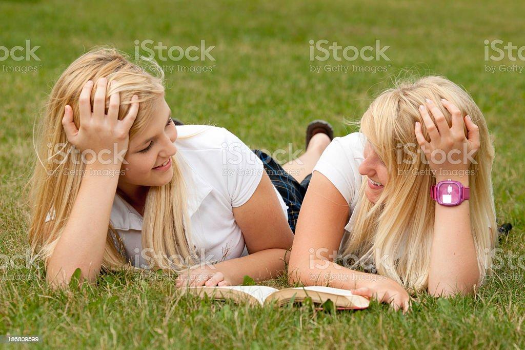 Schoolgirls Book on Grass stock photo