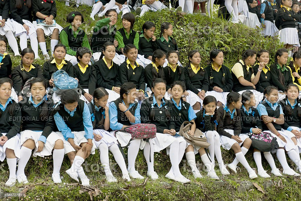 Schoolgirls in Sikkim Watching Soccer royalty-free stock photo