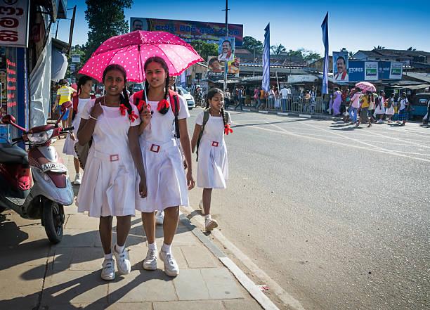 Schoolgirls in white uniforms stock photo