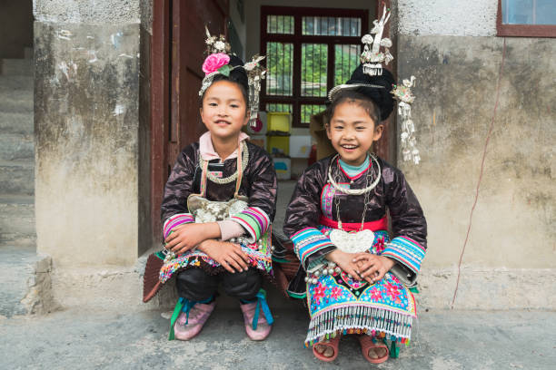 Schoolgirls Together Traditional Dong Clothing, China stock photo