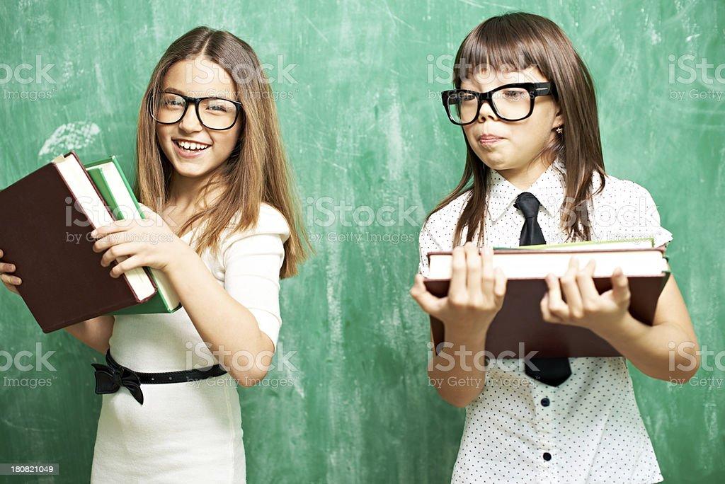 Schoolgirls with books royalty-free stock photo