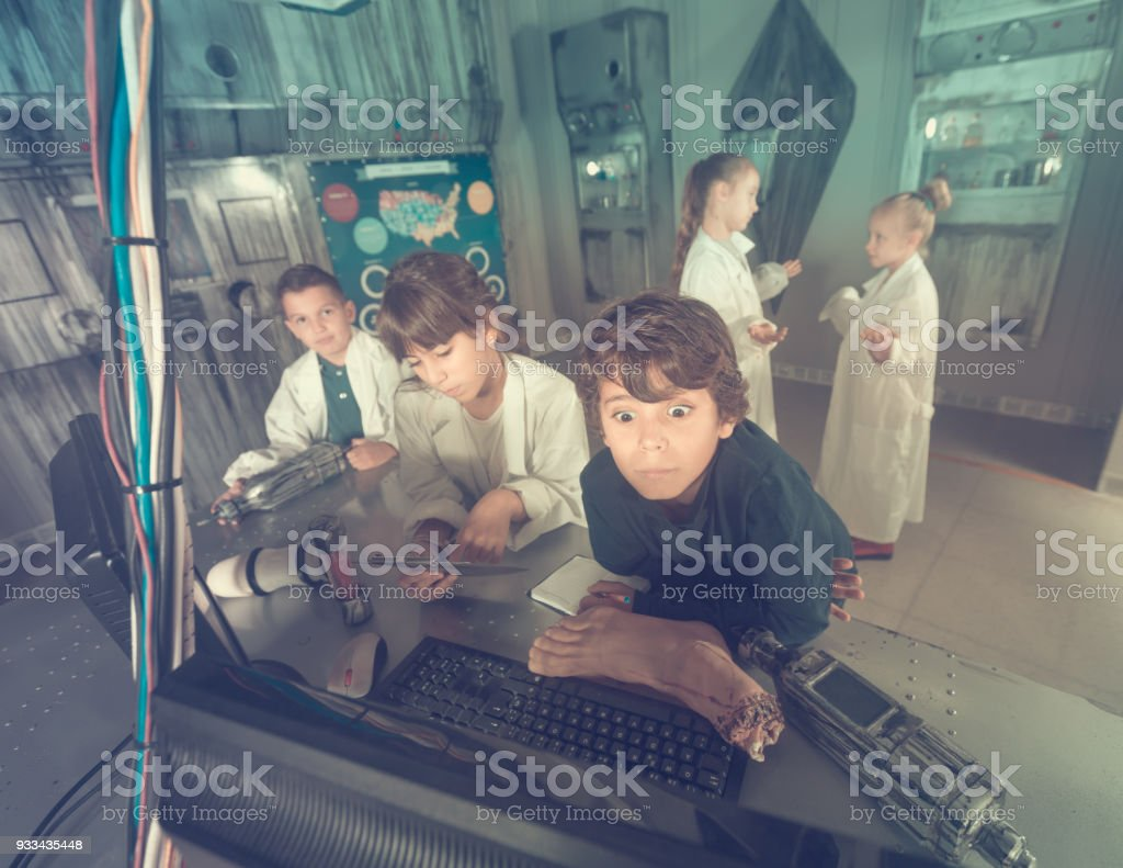 schoolkids solve task in the bunker quest room stock photo
