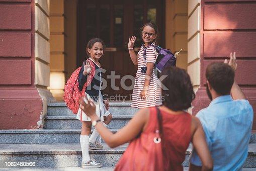 Kids saying goodbye to parents