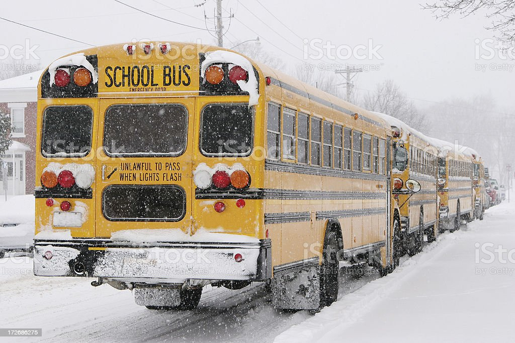 School's Out Early!  Buses in Snow stock photo