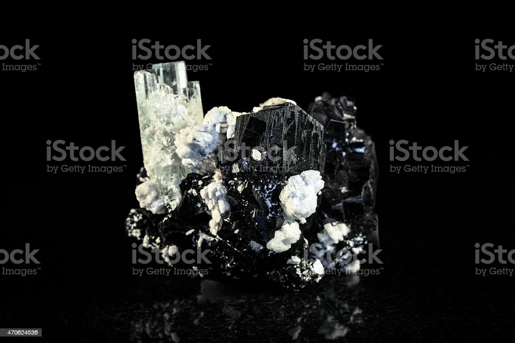 Schorl and Aquamarine crystal in front of black stock photo