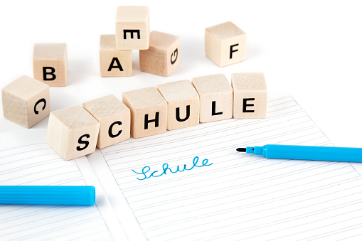 Schule (german for school) written with dices and felt pen