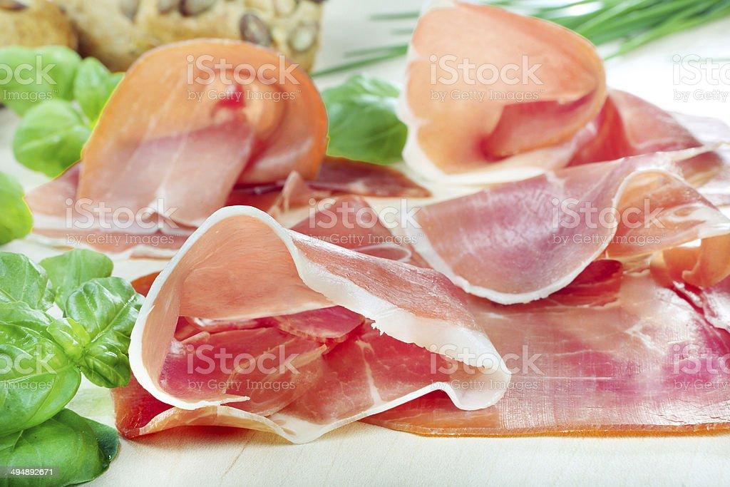 Schwarzwald ham with basil stock photo