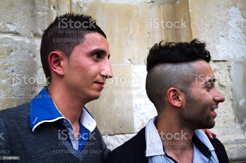 scicli sicily portrait young men with modern hairstyles stock photo