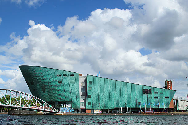 Science Center NEMO Amsterdam, Netherlands - May 7, 2014:  Science Center NEMO - science educational museum in Amsterdam in a beautiful spring day with drmatic cloud nemo museum stock pictures, royalty-free photos & images