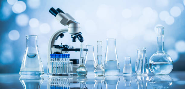 Science laboratory research and development concept. microscope with test tubes - foto stock