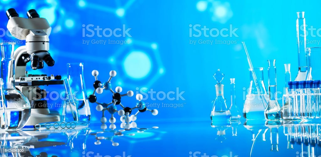 Science laboratory research and development concept. microscope with test tubes stock photo
