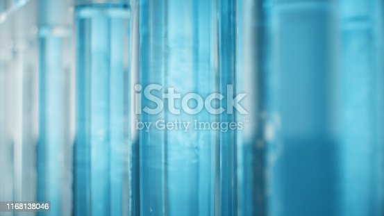 istock Science laboratory research. Development of medical technology. A breakthrough in biotechnology. Blue liquid inside the test tube as fuel. Biotechnology, glassware flasks. Test tubes, 3D Illustration 1168138046
