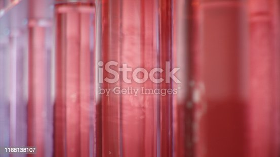 891126112istockphoto Science laboratory research. Development of medical technology. A breakthrough in biotechnology. Red liquid inside the test tube as fuel. Biotechnology, glassware flasks. Test tubes, 3D Illustration 1168138107