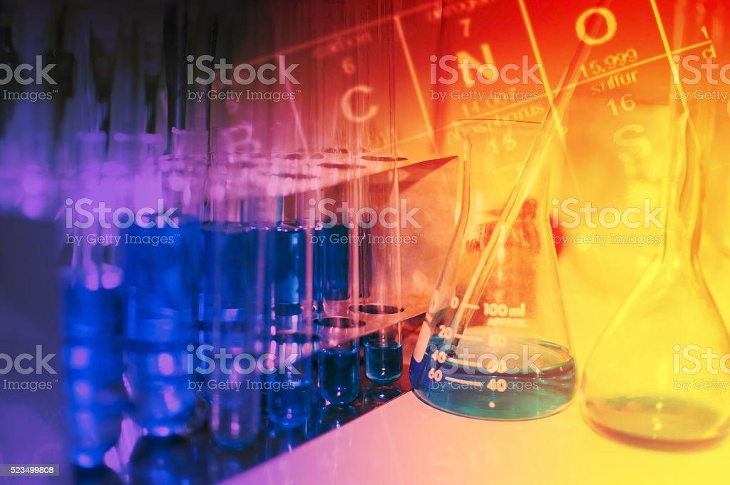 Science laboratory test tubes with periodic table background stock science laboratory test tubes with periodic table background royalty free stock photo urtaz Images