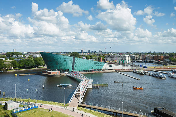 NEMO Science Museum, Amsterdam Amsterdam, Netherlands - July 2, 2016: View of the NEMO Science museum from a top floor of Public Library Amsterdam nemo museum stock pictures, royalty-free photos & images
