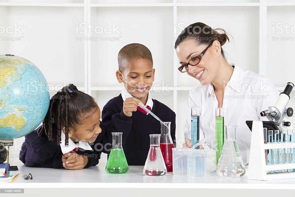 science teacher and students royalty-free stock photo