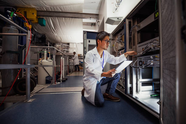 science technician - physics stock photos and pictures