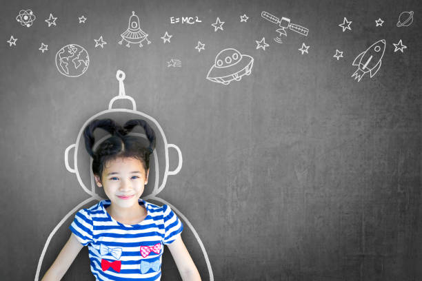 science technology engineering maths stem education concept with school girl kid in astronaut helmet and creative innovative knowledge learning doodle on teacher's chalkboard - teachers day stock photos and pictures