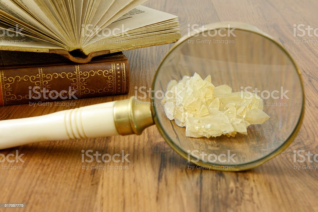 science with Loupe mineral and old book. stock photo