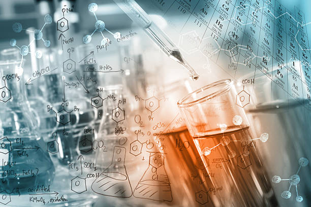 Science/Chemical Concept researcher dropping the clear reagent into test tube with periodic table and chemical equations background, for reaction testing in chemical laboratory. acid stock pictures, royalty-free photos & images