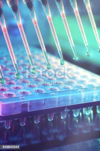 istock Scientific background. Multichannel pipette tips for DNA analysis. 649840344