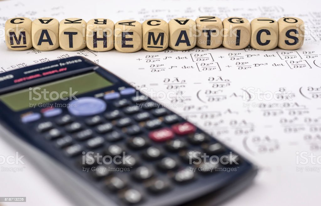 Scientific calculator and mathematical equations stock photo