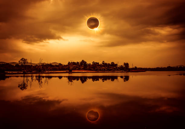 Scientific natural phenomenon. Total solar eclipse with diamond ring effect glowing on sky. stock photo