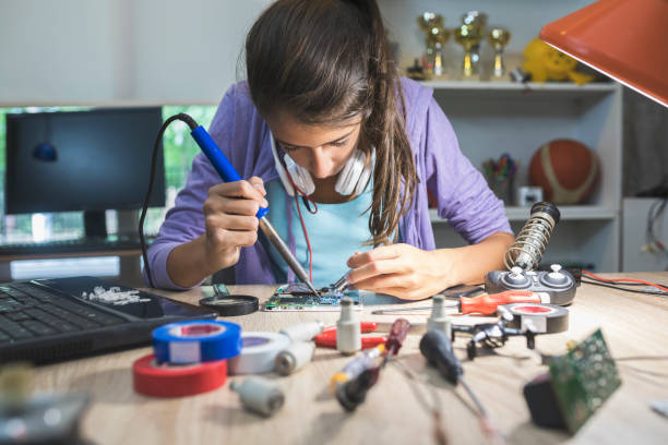 Scientific project Teenage girl working on school project soldering iron stock pictures, royalty-free photos & images