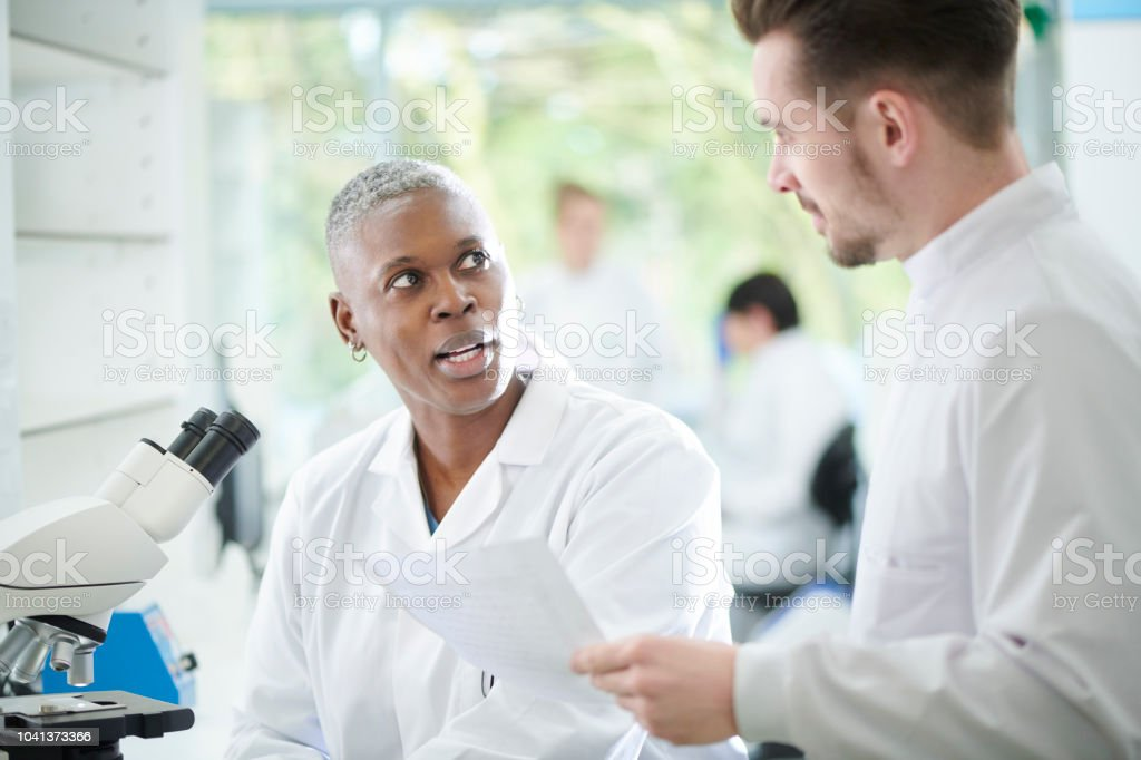 Scientific Research Chat Stock Photo & More Pictures of 30-39 Years