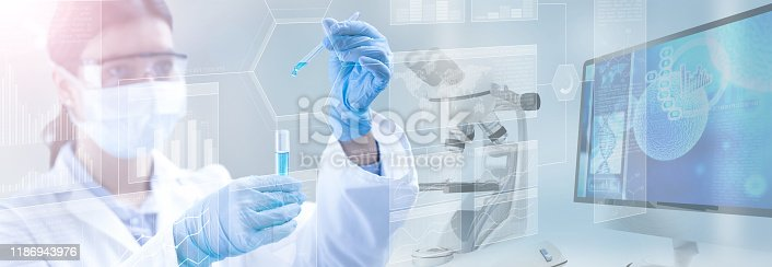 scientist holding a test tube in a scientific background