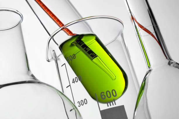 scientific research. lab equipment. - beaker stock photos and pictures