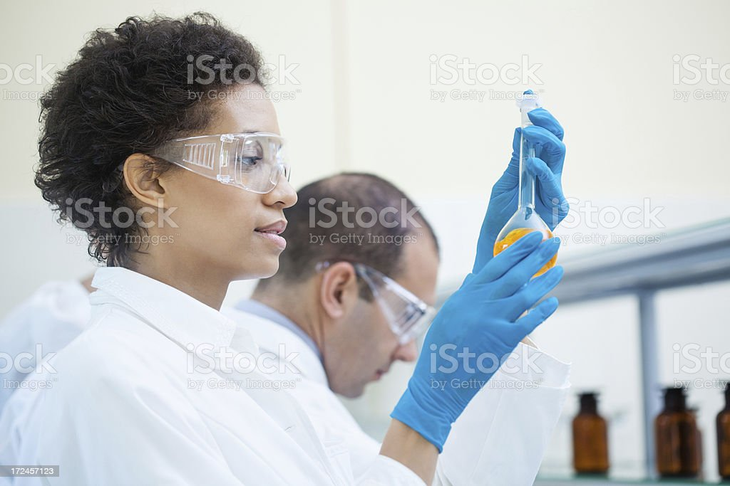 Scientific research team working in a laboratory royalty-free stock photo
