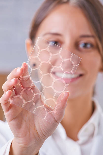 scientific showing a piece of graphene with hexagonal molecule. - graphene stock photos and pictures