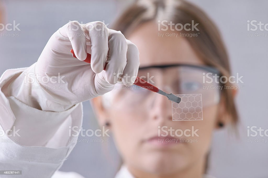 Scientific showing a piece of graphene with hexagonal molecule. stock photo