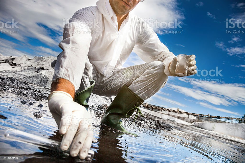 Scientist analyze the water of a river stock photo
