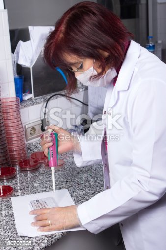 696949550istockphoto Scientist analyzing urine sample in laboratory 180707305