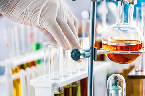 istock Scientist and medical test tools in lab 1135584236