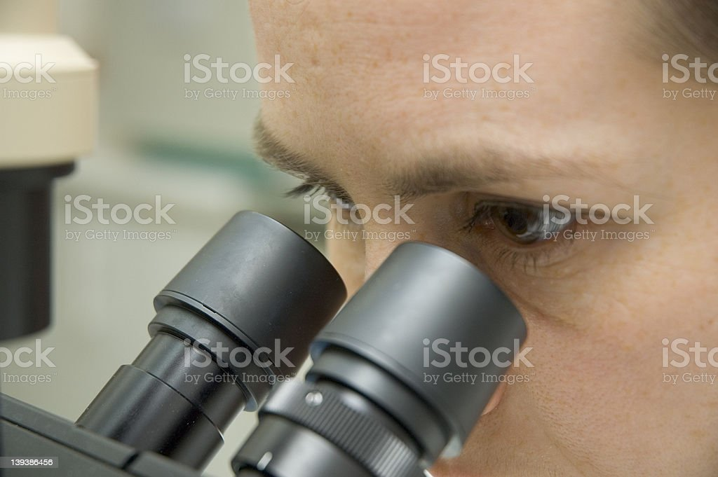 scientist and microscope royalty-free stock photo