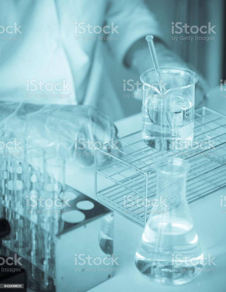 scientist are experimenting with yellow chemicals stock photo