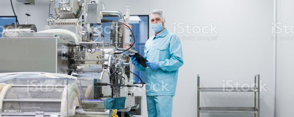 scientist configure machine with shafts stock photo